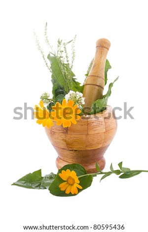 Mortar with herbs and marigolds isolated on white - stock photo