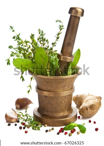 mortar with herbs isolated - stock photo