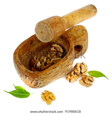 mortar with nuts - stock photo