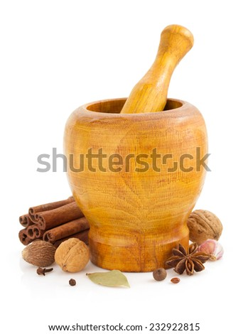 mortar with pestle and spices  on white background - stock photo