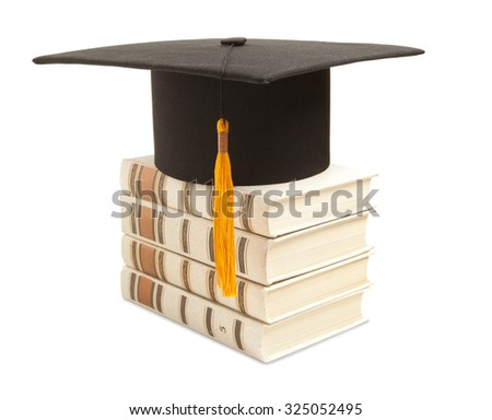 Mortarboard and book, isolated on white - stock photo