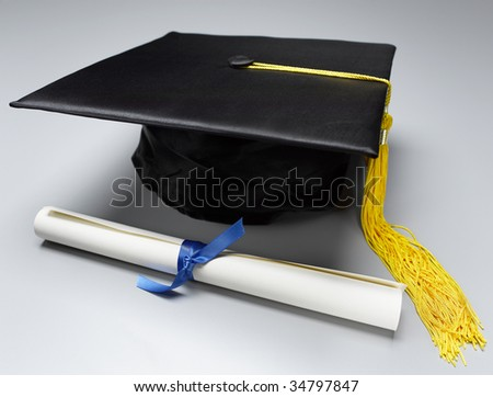 Mortarboard and Diploma - stock photo