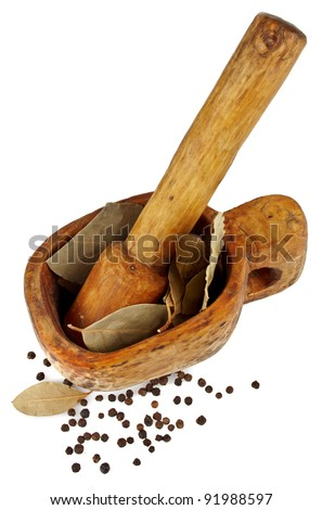 mortat with black pepper and bay leaf - stock photo
