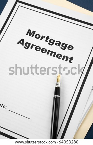 Mortgage Agreement and pen close up - stock photo