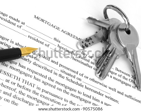 mortgage agreement with pen and keys - stock photo