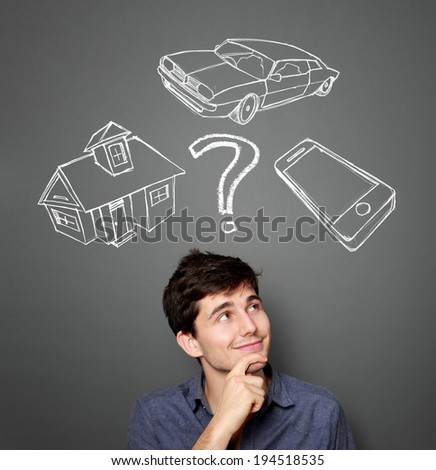 Mortgage and credit concept. Young man planning his future - stock photo