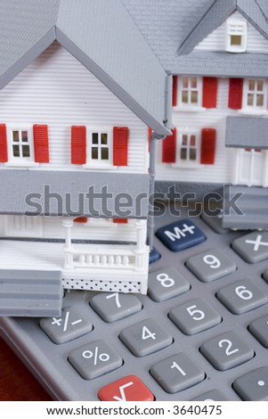 Mortgage and down payment - house and calculator - stock photo