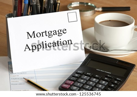 Mortgage application concept with envelope, calculator and pencil - stock photo