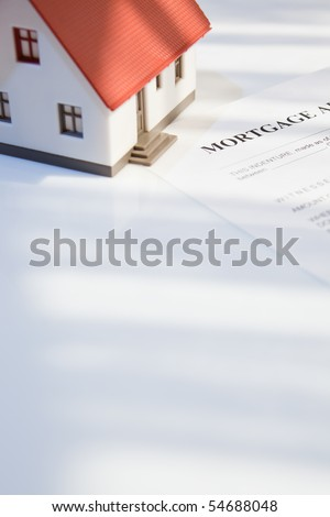mortgage application form with a mini house for real estate - stock photo