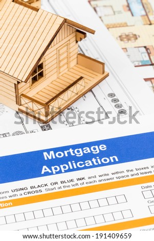 Mortgage application with model house and drawing