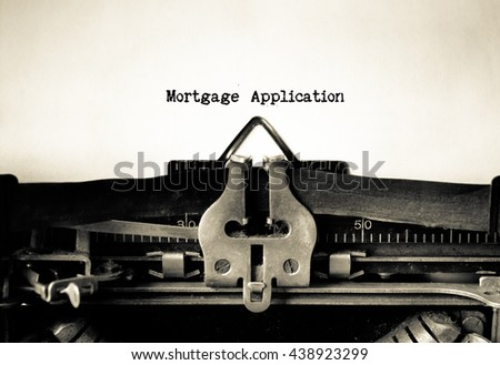 Mortgage Application words  typed on a vintage typewriter - stock photo