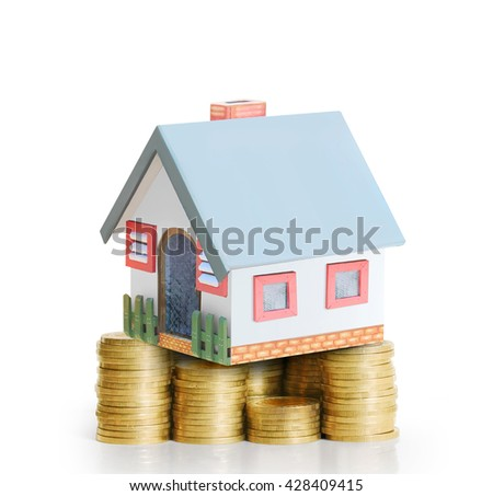 mortgage concept by money house from a coins - stock photo