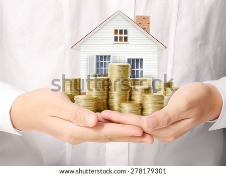 Mortgage concept by money house from the coins