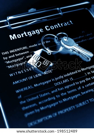 Mortgage contract with keys under blue light - stock photo