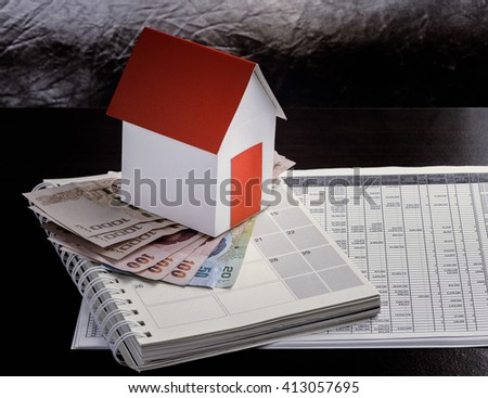 mortgage, investment, real estate and property concept  close up of home model, thai money and house keys - stock photo