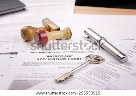Mortgage loan application with rubber stamp - stock photo