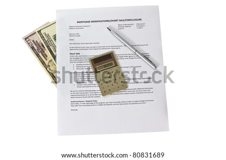 Mortgage modification form with calculator and pen on white background - stock photo