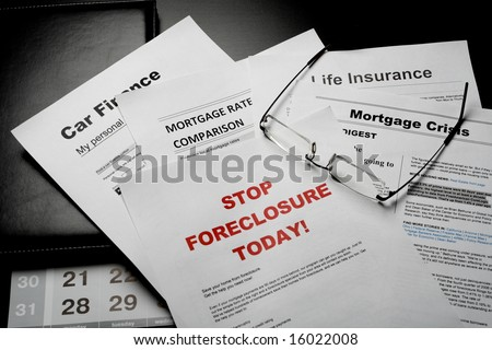 mortgage news papers and eye glasses on the table - stock photo