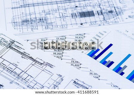 MORTGAGE on spreadsheet and graph - stock photo