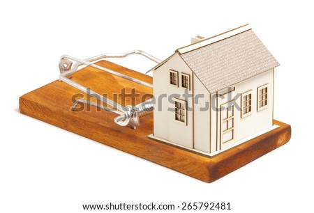 Mortgage payment concept. House on mousetrap isolated on a white background - stock photo