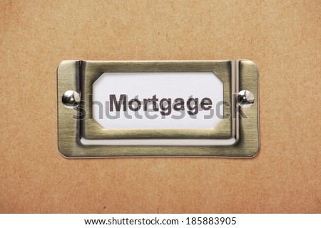 Mortgage Storage Label in a metal holder on a cardboard drawer or box
