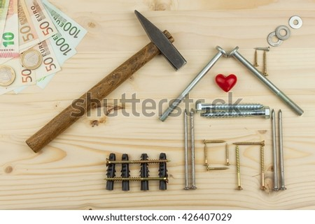 Mortgage to build a house for the family. Real money to build a house. The loan money for housing. Construction of a new house. Plans for the building. Needs for builders. - stock photo