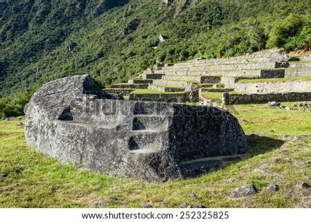 Mortuary rock at Machu Picchu, Incas ruins in the peruvian Andes at Cuzco Peru - stock photo