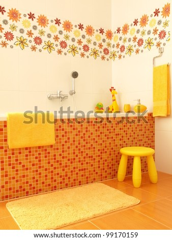 Mosaic bathtub with flower decors for children - stock photo