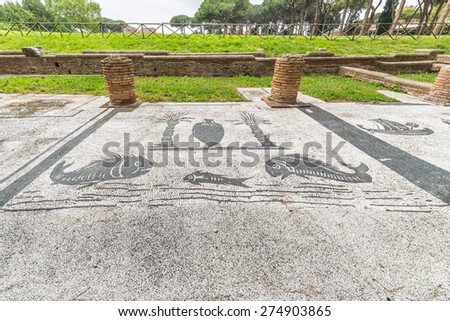 Mosaic details on the floor of the Forum of the Corporations in the old town of Ostia, Rome, Italy, ruins of an ancient roman arrangement of offices for merchants and businessmen. - stock photo