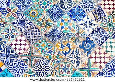 Mosaic formed by tiles of different designs