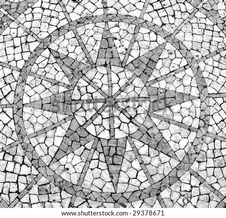 Mosaic in a Portuguese sidewalk featuring a wind rose - stock photo