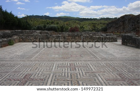 Mosaic in the Ancient Roman ruins of Conimbriga, Portugal. 1st to 2nd centuries. - stock photo