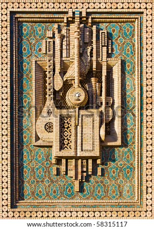 Mosaic of musical instruments made of brick - stock photo