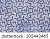 Mosaic of old tiles with abstract design in two shades of blue - stock photo