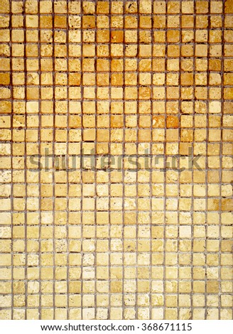 Mosaic tile background. Mosaic wall in antique style. Background tiles with golden colors for your design.