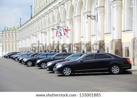 MOSCOW - APR 24: Black government cars with flashers are near Grand Kremlin Palace, Apr 24, 2012 Moscow Russia. Armored limousines Mercedes-Benz S600 (model of Vladimir Putin) weigh from 3 to 3.5 tons - stock photo