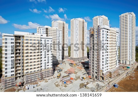 MOSCOW - APR 30: Buildings under construction of residential complex Elk Island, April 30, 2012, Moscow, Russia. This is 12-29 storey buildings with living area of 100 000 square meters. - stock photo
