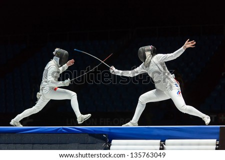 MOSCOW - APR 6: Interesting fight on championship of world in fencing among juniors and cadets, in Sports Olympic complex, on April 6, 2012 in Moscow, Russia - stock photo