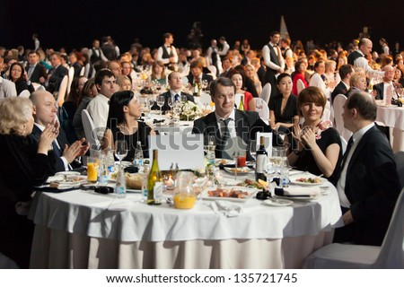 MOSCOW - APR 12: People sitting at the tables during Ceremony of rewarding of winners of an award Brand of year of EFFIE 2011, on April 12, 2012 in Moscow, Russia - stock photo