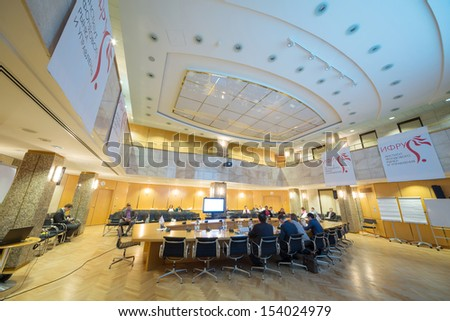 MOSCOW - APR 17: People sitting on 9th Congress IPO in Moscow Stock Exchange on April 17, 2013 in Moscow, Russia. - stock photo