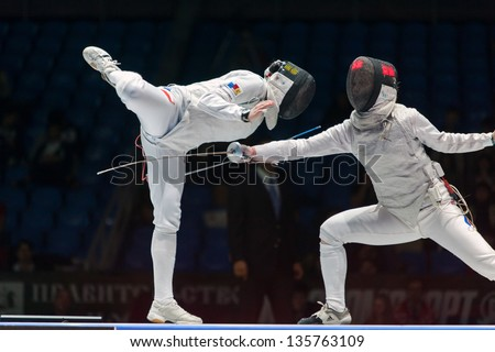 MOSCOW - APR 6: Thrilling battle on championship of world in fencing among juniors and cadets, in Sports Olympic complex, on April 6, 2012 in Moscow, Russia - stock photo