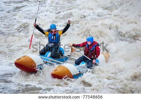 """MOSCOW - APR 10: Unidentified sportsmen train in whitewater rafting techniques in Pakhra river during a traditional spring meeting """"Pakhra 2011"""" on April 10, 2011 in Moscow, Russia. - stock photo"""