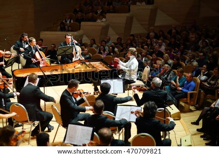 MOSCOW - APR 20, 2015: Violinists and pianist at concert devoted to 100th anniversary of David Ashkenazy in House of Music, Svetlanov hall