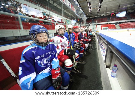 MOSCOW - APR 28: Young players watching on closing ceremony of championship season of 2011-2012 Ice Hockey for Sports School, junior teams on April 28, 2012  in Sokolniki, Moscow, Russia. - stock photo