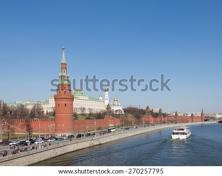 Moscow - April 12, 2015: A view of the Kremlin embankment in Moscow and visible architectural ensemble of the Moscow Kremlin and the tourists go on the ship April 12, 2015, Moscow, Russia