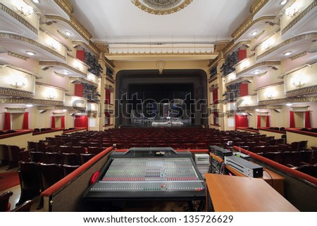 MOSCOW - APRIL 23: Auditorium and stage with packed decorations in Vakhtangov Theatre on April 23, 2012 in Moscow, Russia. Vakhtangov Theatre was established in 1921. - stock photo