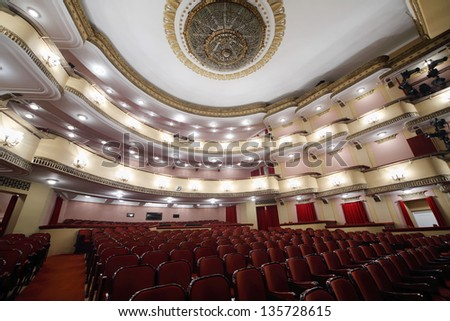 MOSCOW - APRIL 23: Balconies and luster in auditorium in Vakhtangov Theatre on April 23, 2012 in Moscow, Russia. Auditorium of Large stage of theater accommodates 1055 people. - stock photo