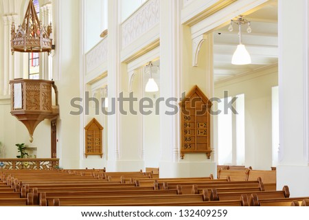 MOSCOW - APRIL 11: Benches and pulpit in Evangelical Lutheran Cathedral of Sts. Peter and Paul, April 11, 2012, Moscow Russia. Construction of Evangelical Lutheran Cathedral was made from 1903 to 1905 - stock photo