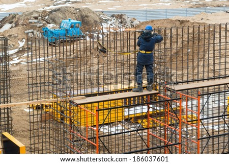 MOSCOW - APRIL 3: Construction site worker on april 3, 2014 in Moscow, Russia. Urban construction is at a faster pace in Russia. - stock photo