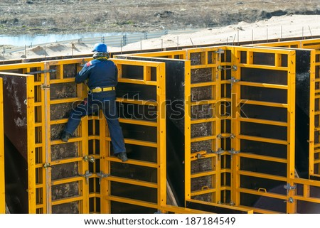 MOSCOW - APRIL 10: Construction site worker on the formwork on april 10, 2014 in Moscow, Russia. Urban construction is at a faster pace in Russia. - stock photo